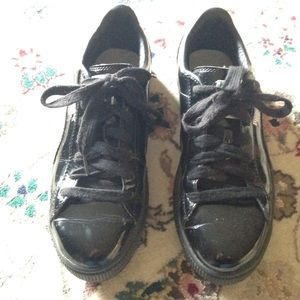 Puma black patent leather sneakers.